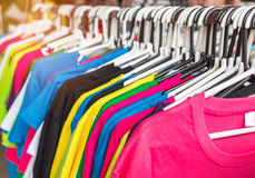 Close up different colors  T- shirt on hangers Royalty Free Stock Images