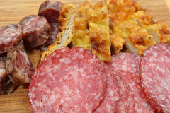 Close up of different meat products (sausages, salami, breaded c Stock Images