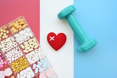 Close up of different medication with red heart and dumbbell Royalty Free Stock Images