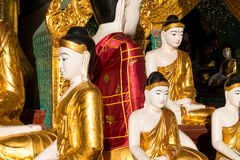 Close up of different sized golden Buddhas Royalty Free Stock Photos