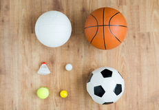 Close up of different sports balls and shuttlecock Royalty Free Stock Images