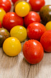 Close up of different tomatoes in vertical format Stock Photo