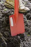 Close up of digging spring soil with sovel Royalty Free Stock Photo