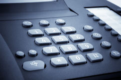 Close up of the digital block of office phone. Blue toned image Stock Photos