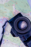 Close-up of digital camera and map. On table Stock Photos