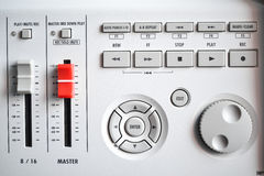 Close up of a digital digital sound mixer. Close up of a portable digital Sound mixer (Red Master slider with buttons and knobs Royalty Free Stock Images