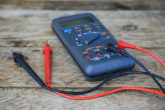 Close-up of digital multimeter on wooden background, Worker used electronic tools for checked circuit Stock Photography