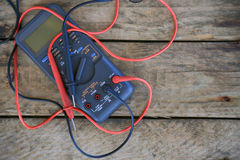 Close-up of digital multimeter on wooden background, Worker used electronic tools for checked circuit Royalty Free Stock Photos
