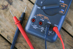 Close-up of digital multimeter on wooden background, Worker used electronic tools for checked circuit Stock Images