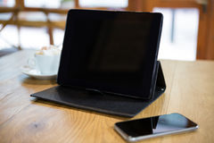 Close-up of digital tablet and smart phone on table Stock Photos