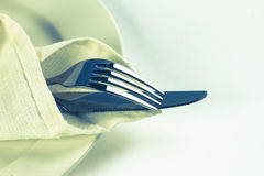 Close up dinning silverware fork  and knife with dish on Stock Photo