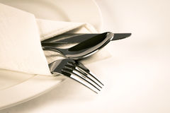 Close up dinning silverware fork , spoon and knife with dish on Stock Photo