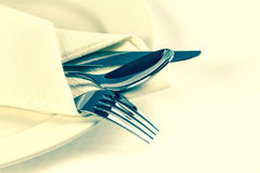 Close up dinning silverware fork , spoon and knife with dish on Royalty Free Stock Images