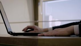 Close Up Of The Director Hand Tapping His Fingers On The Table In The Office. Close up of caucasian man directors hand in a suit working at a desk on a laptop in stock video footage
