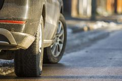Close-up of dirty car parked on a side of the street.  Stock Images