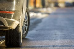 Close-up of dirty car parked on a side of the street.  Stock Photos