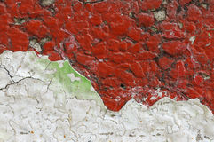 Close up of  dirty, crumbling, red concrete wall Royalty Free Stock Photo