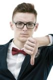 Close-up of a disappointed young business man showing thumb down Stock Photography