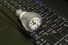 Close up disassembled Led Bulb at the keyboard background.Horizontal. Stock Image