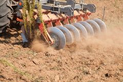 Close up of a disc harrow system, cultivate the soil. Day royalty free stock image
