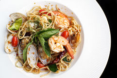 A close up dish of spaghetti. A close up dish of delicious spaghetti with spicy prawns and clams Stock Image