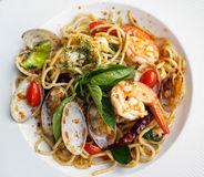 A close up dish of spaghetti. A close up dish of delicious spaghetti with spicy prawns and clams Stock Photos