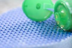 Close-up of dishwashing liquid and sponge Stock Photography