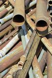 Disorganized stack of old pipes and conduits Stock Images