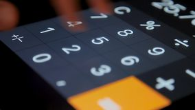 Close Up. A display calculator with changing numbers. Counting on calculator. Close Up. Macro shot. Counting on calculator. A display calculator with changing stock footage