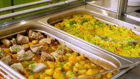 Close-up. display showcase with freshly prepared meals in self-service cafeteria or buffet restaurant. health food