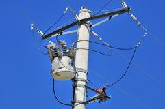 Close-up distribution transformer on concrete power pole Royalty Free Stock Photo