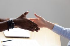 Close up diverse business people shaking hands stock photography