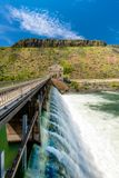 Close up of the Diversion Dam on the Boise River with water flowing through it. Water flowers over and through a Diversion Dam on the Boise River in Idaho stock image