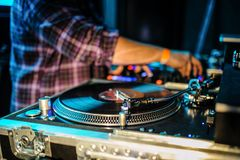 Close up of dj control panel playing party music on modern player in disco club. Nightlife and entertainment concept. Defocused background with shallow depth royalty free stock image