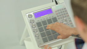 Close up of DJ mixing music on a panel of the midi stock video
