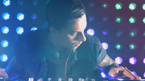 Close-up. DJ playing at the disco. Nightlife concept. stock footage