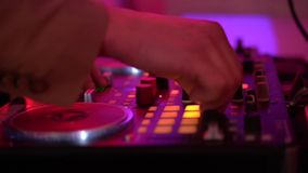 Close up of dj playing party music on modern cd usb player in disco club stock video footage