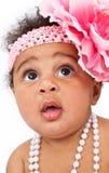Close up do bebê bonito com Headband da flor Foto de Stock
