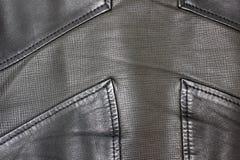 Close up do casaco de cabedal Fundo de couro fotografia de stock
