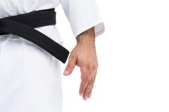 Close-up do cinturão negro do karaté no uniforme branco fotografia de stock
