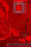 Close up do circuito eletrônico vermelho do cartão-matriz com processador Fotos de Stock