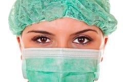 Close-up do doutor fêmea com máscara e o tampão verdes Imagens de Stock Royalty Free