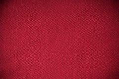 Close up do material de matéria têxtil vermelho da tela como a textura ou o fundo Imagem de Stock Royalty Free