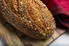 Close up do naco cortado do pão inteiro da grão Fotografia de Stock