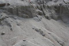 Close up do teste padrão da areia de uma praia Fotografia de Stock