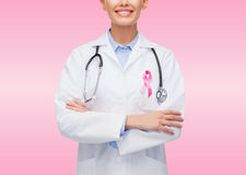 Close up of doctor with cancer awareness ribbon Royalty Free Stock Photography