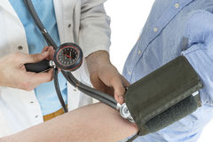 Close Up Of A Doctor Checking Blood Pressure Of A Patient stock photos