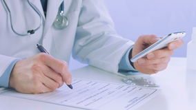 Close up of a doctor hand holding and using a stock footage
