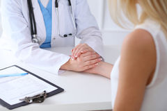 Close up of doctor hands reassuring her female patient Royalty Free Stock Images