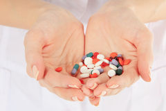 Close-up of doctor holding a pills in the hands Stock Photo